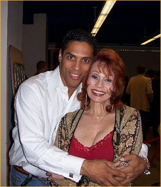 With Taimak Guarriello
